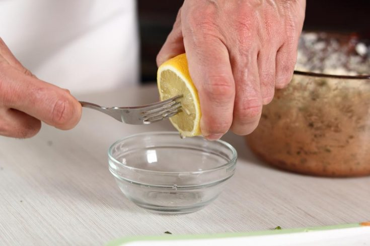 Squeeze a lemon with fork