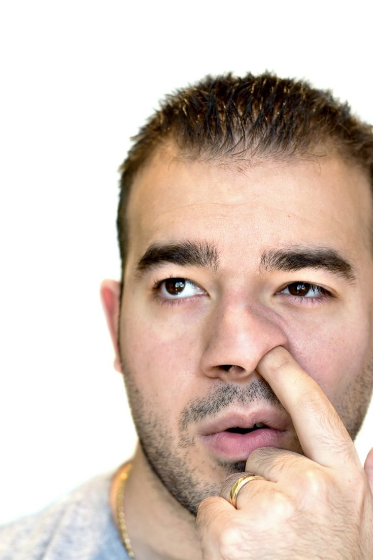 this man is a nose picker