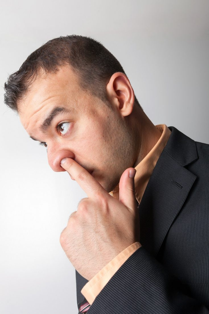 a man is picking his nose